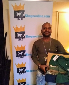 man posing with new green sneakers with ezshopz banner behind