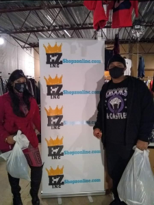 two people with bags with ezshopz banner in the middle